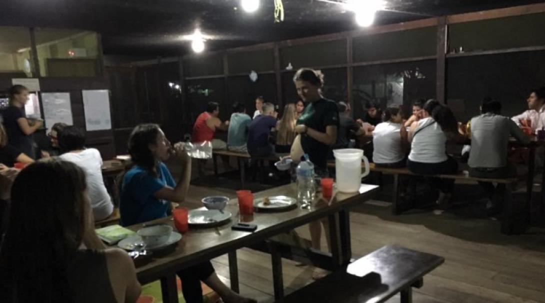 Volunteers eating in the dining room